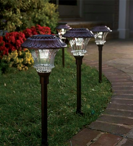 Set Of 4 Steel And Glass Encased Solar Led Path Lights