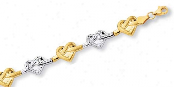 10k Two-tone Twisted Heart Link Bracelet - 7.25 Inch