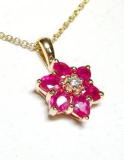 Oval Ruby & Diamond Flower Pendant